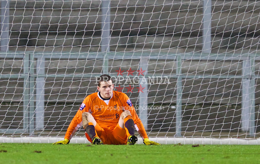 ST. HELENS, ENGLAND - Wednesday, January 15, 2014: Liverpool's goalkeeper Ryan Crump looks dejected after conceding the first goal to Aston Villa during the FA Youth Cup 4th Round match at Langtree Park. (Pic by David Rawcliffe/Propaganda)
