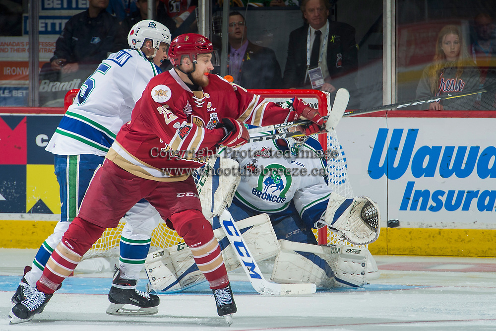 REGINA, SK - MAY 19: Stuart Skinner #74 of Swift Current Broncos makes a save against the Acadie-Bathurst Titan at the Brandt Centre on May 19, 2018 in Regina, Canada. (Photo by Marissa Baecker/CHL Images)