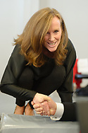 "Westbury, New York, USA. January 15, 2017. Representative KATHLEEN RICE (Democrat - 4th Congressional District NY) bends down on stage to shake hands with members of the public at end of the ""Our First Stand"" Rally against Republicans repealing the Affordable Care Act, ACA, taking millions of people off health insurance, making massive cuts to Medicaid, and defunding Palnned Parenthood. Hosts were Reps. Rice and Thomas Suozzi (Dem. - 3rd Congress. Dist.)."