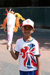 © Licensed to London News Pictures. 25/07/2012. London, U.K..members of the crowd with their own torches as The Olympic torch relay reaches Wembley Stadium today 25/7/2012, two days before the London Olympic 2012 games begin..Photo credit : Rich Bowen/LNP