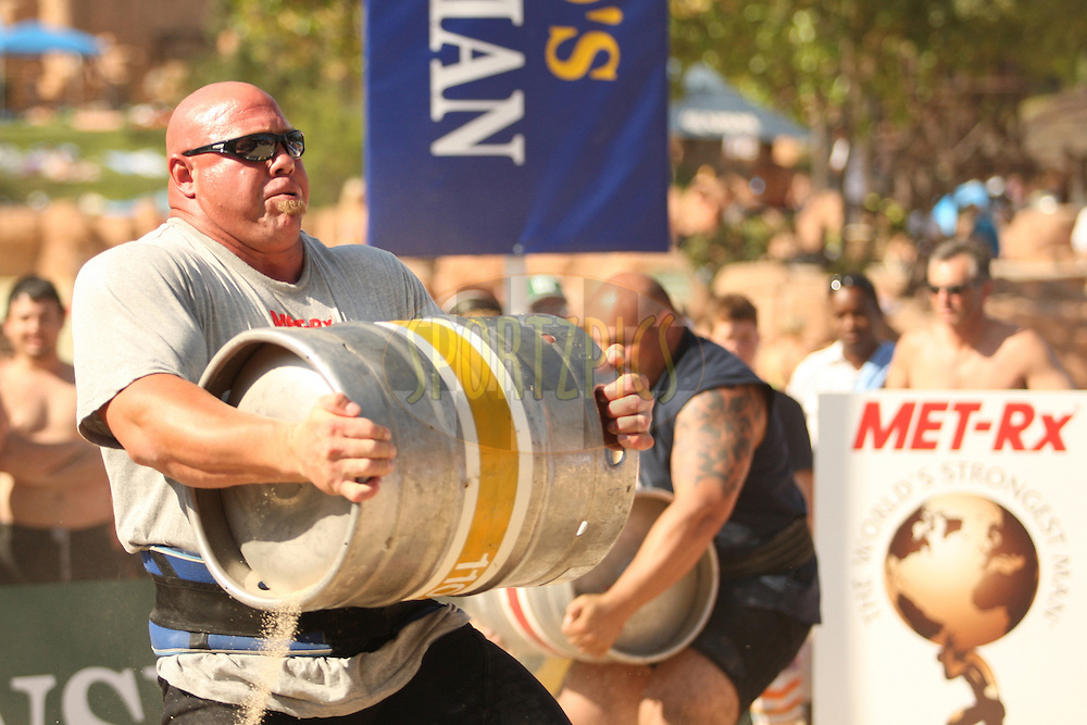 Nick Best (USA) takes the lead over Laurence Shahlaei (UK) in the keg race, one of the qualifying rounds of the World's Strongest Man competition held in Sun City, South Africa.