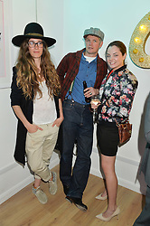 Left to right, SOPHIA PACK, TARQUIN PACK and SYDNEY VESSELS at a private view of an exhibition entitled 'All Shook Up' - by Natasha Archdale: A Retrospective held at 90 Piccadilly, London on 23rd April 2015.