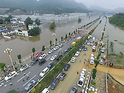 BIJIE, CHINA - JUNE 28: <br /> <br />  Aerial view of vehicles near the flood caused by heavy rain in Zhijin County on June 28, 2016 in Bijie, Guizhou Province of China. Over 10 hours continuous heavy rain caused 2 people died, 1 still missing and the direct economic loss of 115.62 million yuan (about 17.39 million USD) till Tuesday in Zhijin County, Guizhou Province. <br /> ©Exclusivepix Media