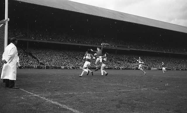 Meath's W. Monagher tackles Cork's D. Morley as he jumps for possession during the All Ireland Minor Gaelic Football Final Cork v. Laois in Croke Park on the 24th September 1967.