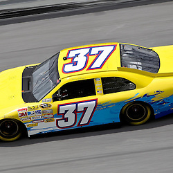 April 16, 2011; Talladega, AL, USA; NASCAR Sprint Cup Series driver Tony Raines (37) during qualifying for the Aarons 499 at Talladega Superspeedway.   Mandatory Credit: Derick E. Hingle