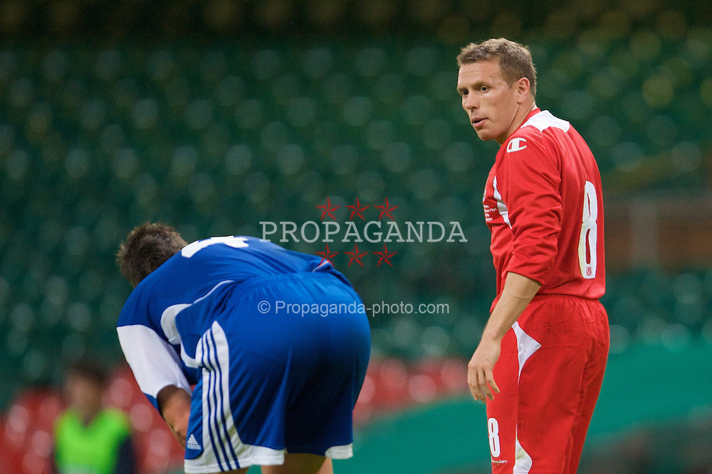 CARDIFF, WALES - Saturday, October 11, 2008: Wales' captain Craig Bellamy argues with Liechtenstein's Fabio D'Elia during the 2010 FIFA World Cup South Africa Qualifying Group 4 match at the Millennium Stadium. (Photo by David Rawcliffe/Propaganda)