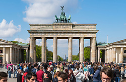 Many tourists at Brandenburg Gate in Berlin Germany