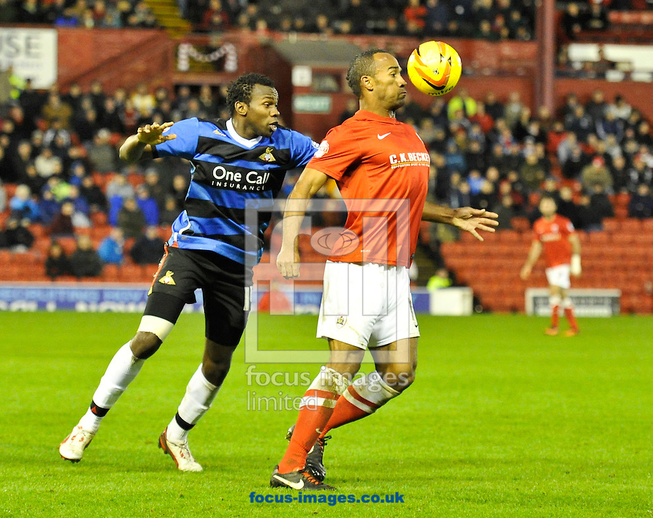 Picture by Richard Land/Focus Images Ltd +44 7713 507003<br /> 09/11/2013<br /> Chris O'Grady of Barnsley and Bongani Khumalo of Doncaster Rovers during the Sky Bet Championship match at Oakwell, Barnsley.