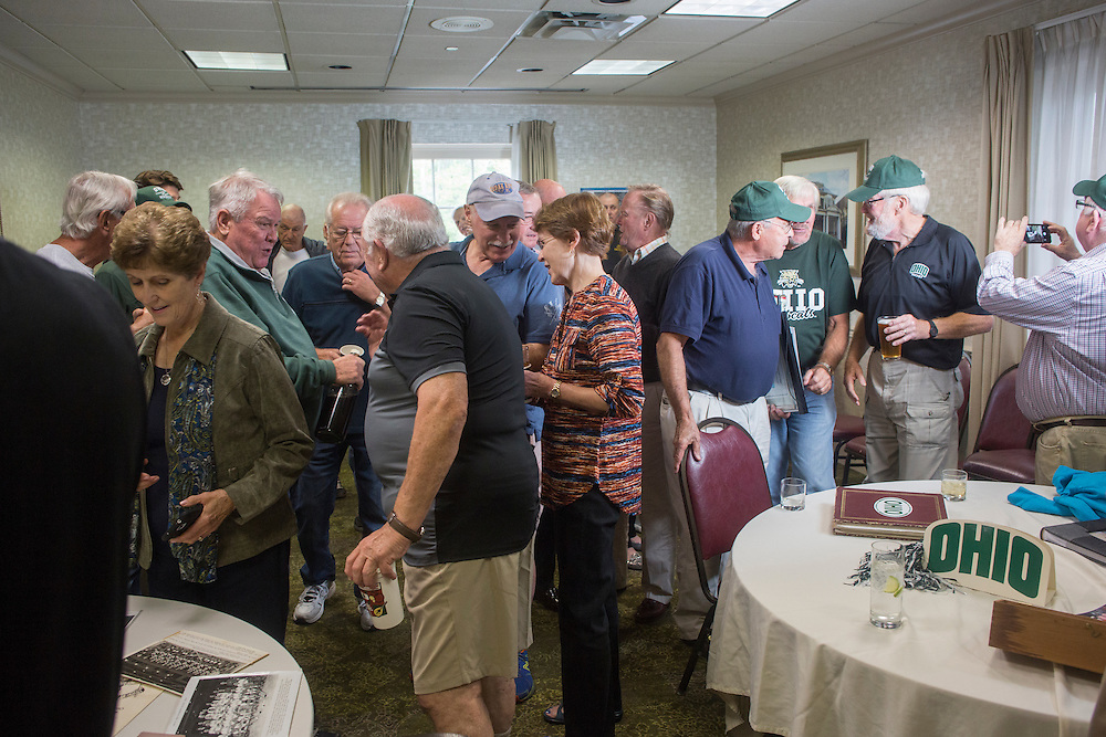 Alumi from the 1960s OU hockey team and their families gather at the OU Inn during their reunion weekend on October 1, 2016.