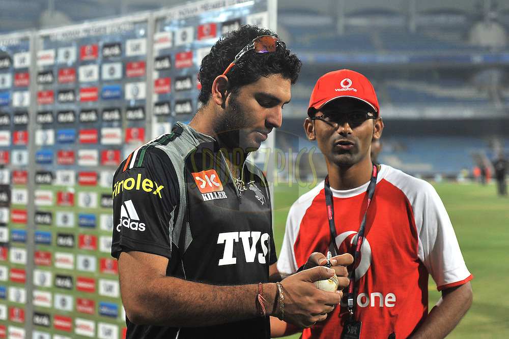 Yuvraj Singh Captain of Pune Warriors India signs the ball for the vodafone winner during  match 10 of the Indian Premier League ( IPL ) Season 4 between the Pune Warriors and the Kochi Tuskers Kerala held at the Dr DY Patil Sports Academy, Mumbai India on the 12th April 2011..Photo by Pal Pillai /BCCI/SPORTZPICS