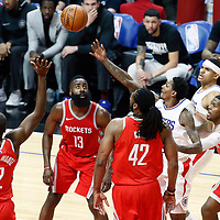 28 February 2018: LA Clippers guard Lou Williams (23) goes for the layup past Houston Rockets guard James Harden (13) and Houston Rockets center Nene Hilario (42) during the Houston Rockets 105-92 victory over the LA Clippers, at the Staples Center, Los Angeles, California, USA.