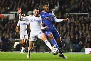 Jack Harrison of Leeds United (22) and Jordan Spence of Ipswich Town (12) come together during the EFL Sky Bet Championship match between Leeds United and Ipswich Town at Elland Road, Leeds, England on 24 October 2018.