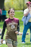 Emily Allen goes up to accept her award for having the best female overall completion time during the Race for a Reason Mud Run, Saturday, April 27, 2013. Allen is from Lebanon, OH, and is a junior at Ohio University. Race for a Reason, Race 4 A Reason, Annual Events, Events, Students, Faculty & Staff