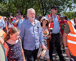 © Licensed to London News Pictures.  22/07/2018; Tolpuddle, Dorset, UK. JEREMY CORBYN, leader of the Labour Party, attends the procession of trade union banners through the village of Tolpuddle, part of the Tolpuddle Martyrs Festival. The Tolpuddle Martyrs Festival for trade unionism, held every year, commemorates the birth of the trade union movement in the 19th century when the Tolpuddle Martyrs were transported to Australia for forming a trade union of agricultural labourers in Dorset. This year is also the 150th anniversary of the TUC. Photo credit: Simon Chapman/LNP