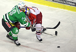 Pasi Petrilainen of Olimpija and Thomas Koch of Salzburg at sixth game of the Final of EBEL league (Erste Bank Eishockey Liga) between ZM Olimpija vs EC Red Bull Salzburg,  on March 25, 2008 in Arena Tivoli, Ljubljana, Slovenia. Red Bull Salzburg won the game 3:2 and series 4:2 and became the Champions of EBEL league 2007/2008.  (Photo by Vid Ponikvar / Sportal Images)..