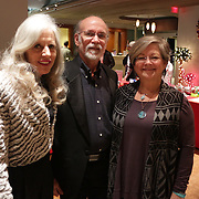 Mary Baggett, left, Phil Abbott, center, and Jayme Bednarczyk pose for a photo Friday November 28, 2014 during the Atlantic Marine Holiday Flotilla Launch Party. (Jason A. Frizzelle)