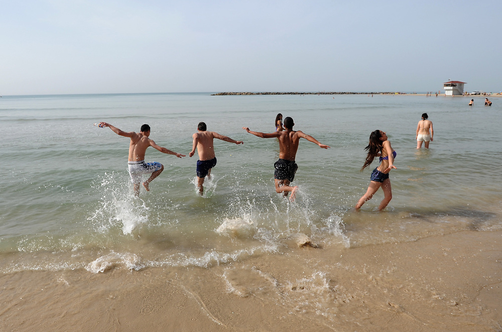 Israelis enjoy the sunny day in Sironit Beach at the coastal city of Netanya. March 08, 2010. Photo by Gili Yaari