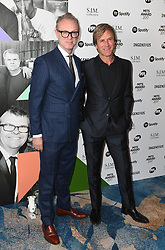 Gary Kemp (left) and Steve Norman from Spandau Ballet arriving for the 26th Annual Music Industry Trusts Awards held at the Grosvenor House Hotel, London. Picture credit should read: Doug Peters/Empics Entertainment
