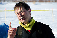 Martin Buser talks to volunteers and fans in the Iditarod checkpoint.