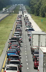 September 8, 2017 - Wildwood, Florida, U.S. - Traffic rolls at a crawl on the northbound lanes of Florida's Turnpike near the intersection of I-75 in Wildwood on Friday. Tens of thousands of people are attempting to leave the area causing severe gridlock. Hurricane Irma is expected to make landfall near South Florida by Sunday morning. (Credit Image: © Stephen M. Dowell/TNS via ZUMA Wire)