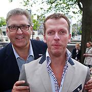 NLD/Amsterdam/20110731 - Premiere circus Hurricane met Hans Klok, Henk Krol en partner Reon Nettenbreijers