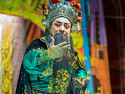 "26 NOVEMBER 2014 - BANGKOK, THAILAND: A Chinese opera performance at the Chow Su Kong Shrine in the Talat Noi neighborhood of Bangkok. Chinese opera was once very popular in Thailand, where it is called ""Ngiew."" It is usually performed in the Teochew language. Millions of Chinese emigrated to Thailand (then Siam) in the 18th and 19th centuries and brought their culture with them. Recently the popularity of ngiew has faded as people turn to performances of opera on DVD or movies. There are about 30 Chinese opera troupes left in Bangkok and its environs. They are especially busy during Chinese New Year and Chinese holidays when they travel from Chinese temple to Chinese temple performing on stages they put up in streets near the temple, sometimes sleeping on hammocks they sling under their stage.      PHOTO BY JACK KURTZ"