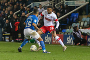 Julien Lamy (26) up against Nathan Thompson (15) during the EFL Sky Bet League 1 match between Peterborough United and Rotherham United at London Road, Peterborough, England on 25 January 2020.