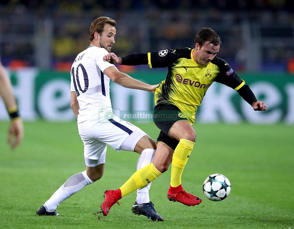 Tottenham Hotspur's Harry Kane (left) and Borussia Dortmund's Mario Gotze (right) battle for the ball
