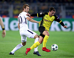 Tottenham Hotspur's Harry Kane (left) and Borussia Dortmund's Mario Gotze (right) battle for the ball