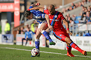 Chesterfield defender Paul McGinn and Rochdale forward Calvin Andrew battle it out for the ball during the EFL Sky Bet League 1 match between Chesterfield and Rochdale at the Proact stadium, Chesterfield, England on 25 March 2017. Photo by Aaron  Lupton.