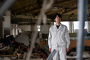 Hideharu Sasaki, 39, stands inside the sports center where he was almost drowned following the March 11 tsunami in Rikuzebtakata, Iwate Prefecture, Japan on 09 March 2012. Around 100 people died in the sports center, while 4 people, including Sasaki, survived. Photographer: Robert Gilhooly.