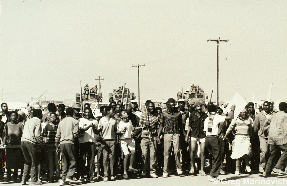 Ivory Park, Thembisa, Johannesburg, Transvaal, South Africa, 1991: People trying to squat on open land earmarked for more formal development demonstrate for the right to settle in Ivory Park.