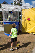 Mayor Greg Lemons in the dunking booth at the Abita Springs Water Festival on October 16, 2016