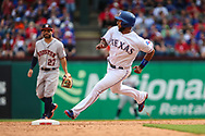 March 29, 2018 - Arlington, TX, U.S. - ARLINGTON, TX - MARCH 29: Texas Rangers shortstop Elvis Andrus (1) rounds second base and heads towards third during the game between the Texas Rangers and the Houston Astros on March 29, 2018 at Globe Life Park in Arlington, Texas. Houston defeats Texas 4-1. (Photo by Matthew Pearce/Icon Sportswire) (Credit Image: © Matthew Pearce/Icon SMI via ZUMA Press)