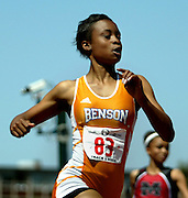 05/23/2009 - Benson's Kayla Smith eases across the finish line to win the 6A Girl's 100 Meter Dash. The 2009 OSAA/U.S. Bank/Les Schwab Tires 6A-5A-4A Track and Field State Championships were run at Hayward Field in Eugene, Oregon.....KEYWORDS:  City, Portland, sports, Oregon, high school, OSAA, boys, girls, PIL, run, University, team