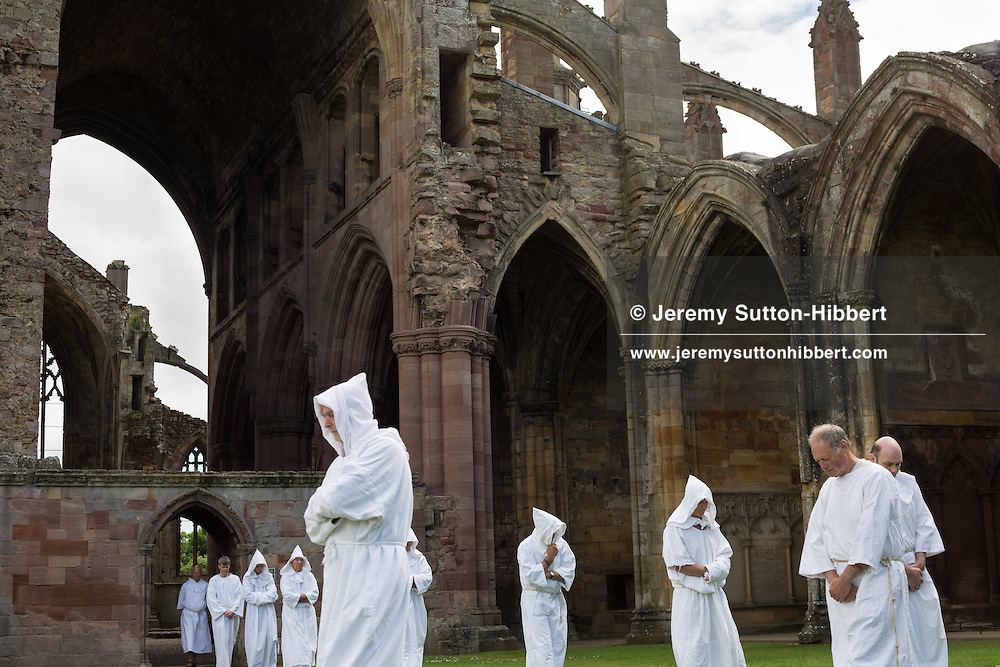 A stop during The Tour Of Ceremonies at Melrose Abbey, with local people dressed as monks and Kind David, and with Melrosian Sam Thomson and Festival Queen Zoe Palmer, and their courts, laying a wreath over the spot which some believes marks the location of the heart of Robert The Bruce, during the Melrose Festival, near Melrose, Scotland, Saturday 22nd June 2013.<br /> N55&deg;35.948'<br /> W2&deg;43.115'