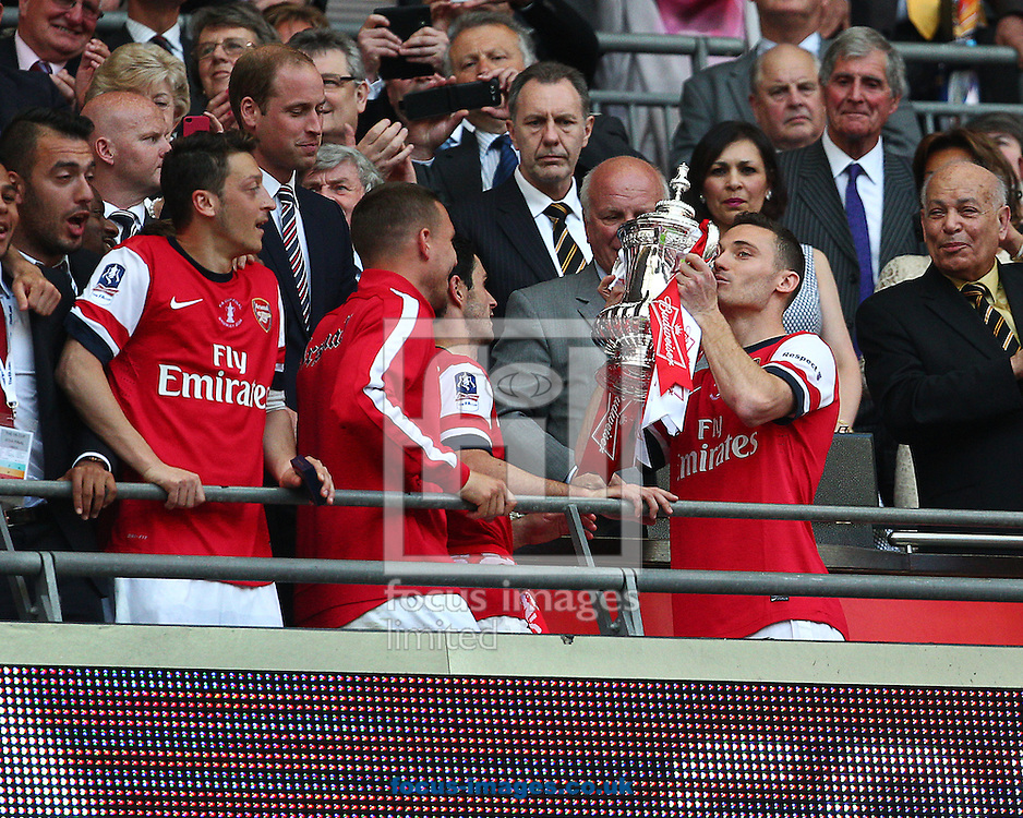 Thomas Vermaelen ( R ) of Arsenal lifts the FA Cup after his team win during  the The FA Cup Final match at Wembley Stadium, London<br /> Picture by Paul Terry/Focus Images Ltd +44 7545 642257<br /> 17/05/2014