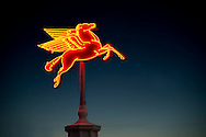This vintage neon Pegasus was preserved through an agreement between Mobil Oil and the San Antonio Conservation Society, marking the first time a company's trademark was permanently loaned to a private entity.