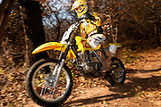 Summer Hopkins on her Suzuki dirt bike