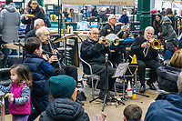 Jazz musicians at St George's Market, Belfast, N Ireland, UK, 16th November 2019, 201911161768<br /><br />Copyright Image from Victor Patterson, Belfast, UK<br /><br />t: +44 28 9066 1296 (from Rep of Ireland 048 9066 1296)<br />m: +44 7802 353836<br /><br />victorpattersonbelfast@gmail.com<br />www.victorpatterson.com<br /><br />Please see my Terms and Conditions of Use at https://www.victorpatterson.com/page2<br />It is IMPORTANT that you familiarise yourself with them.<br /><br />Images used online incur an additional cost and must be visibly watermarked i.e. © Victor Patterson within the body of the image and copyright metadata must not be deleted. Images used on the Internet have a size restriction of 4kbs and are chargeable at rates available at victorpatterson.com.<br /><br />This image is only available for the use of the download recipient i.e. television station, newspaper, magazine, book publisher, etc, and must not be passed on to any third party. It is also downloaded on condition that each and every subsequent usage is notified within 7 days to victorpattersonbelfast@gmail.com<br /><br />The right of Victor Patterson to be identified as the author is asserted in accordance with The Copyright Designs And Patents Act (1988). All moral rights are asserted.