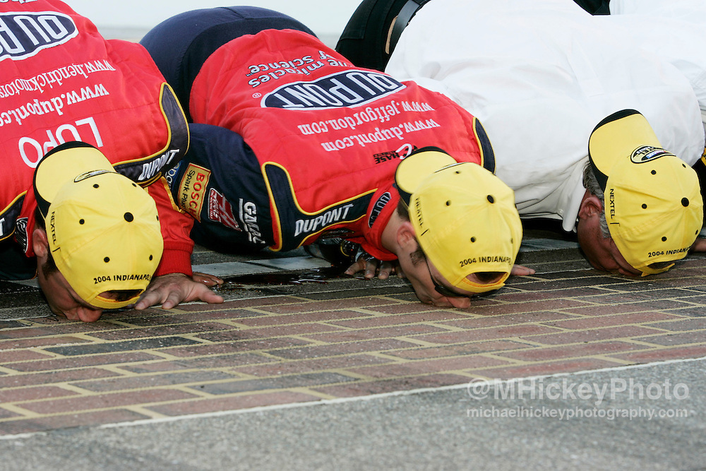 """Jeff Gordon peforms the traditional """"kiss the bricks"""" following his win in the Brickyard 400"""