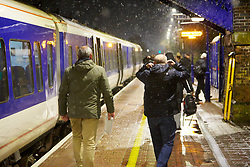 © Licensed to London News Pictures. 29/01/2019. STOKE MANDEVILLE, UK.  Commuters react to snow as they get off a train at Stoke Mandeville station. Rain is expected to turn to snow across large parts of the south of England and the Met Office has issued a yellow warning of snow and ice overnight.  Photo credit: Cliff Hide/LNP