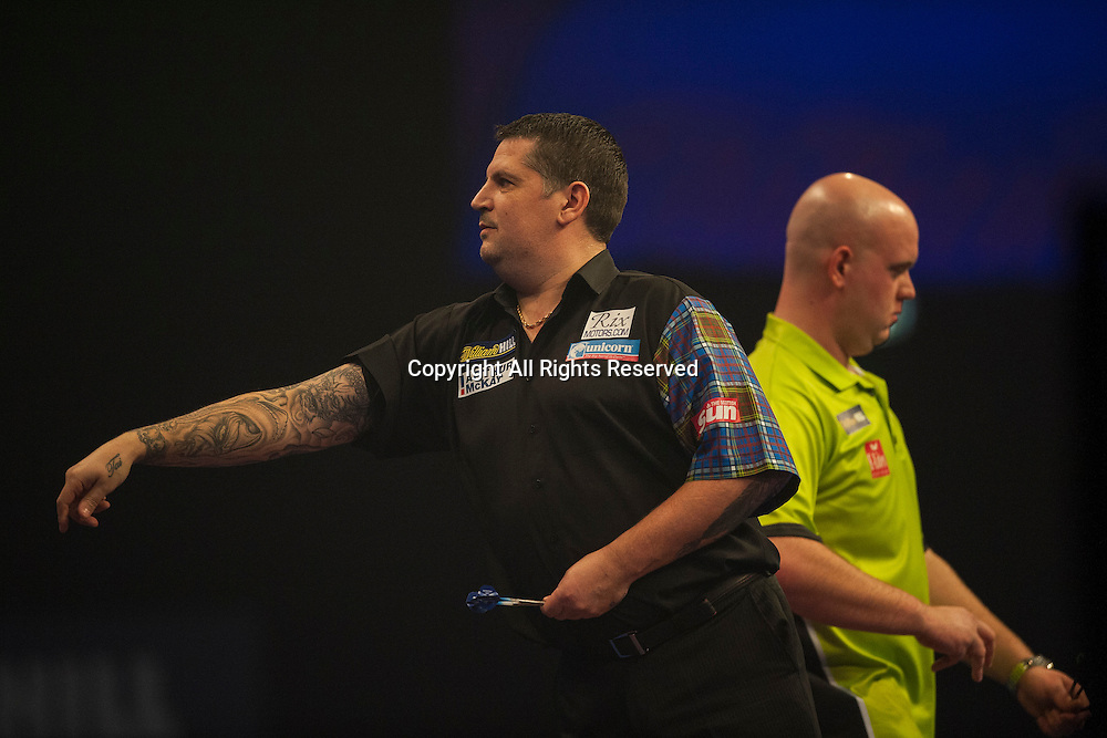 03.01.2015.  London, England.  William Hill PDC World Darts Championship.  Semi Final Round.  Gary Anderson (4) [SCO] in action during his game with Michael van Gerwen (1) [NED]