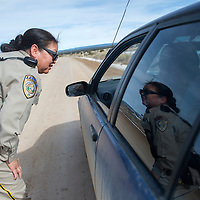 Ramah Police Officer Aileen Evens gives a verbal warning to a passenger of a car for not wear his seatbelt during her routine drive of the roads in Ramah on January 23.