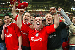 CARDIFF, WALES - Sunday, March 2, 2003: Liverpool fans celebrate Michael Owen's goal against Manchester United during the Football League Cup Final at the Millennium Stadium. (Pic by David Rawcliffe/Propaganda)