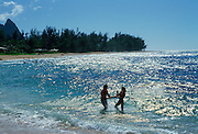 Couple in ocean, Hawaii<br />