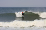 Surfer at the Marconi Beach, Cape Cod, Massachusetts, USA, September 3, 2011.