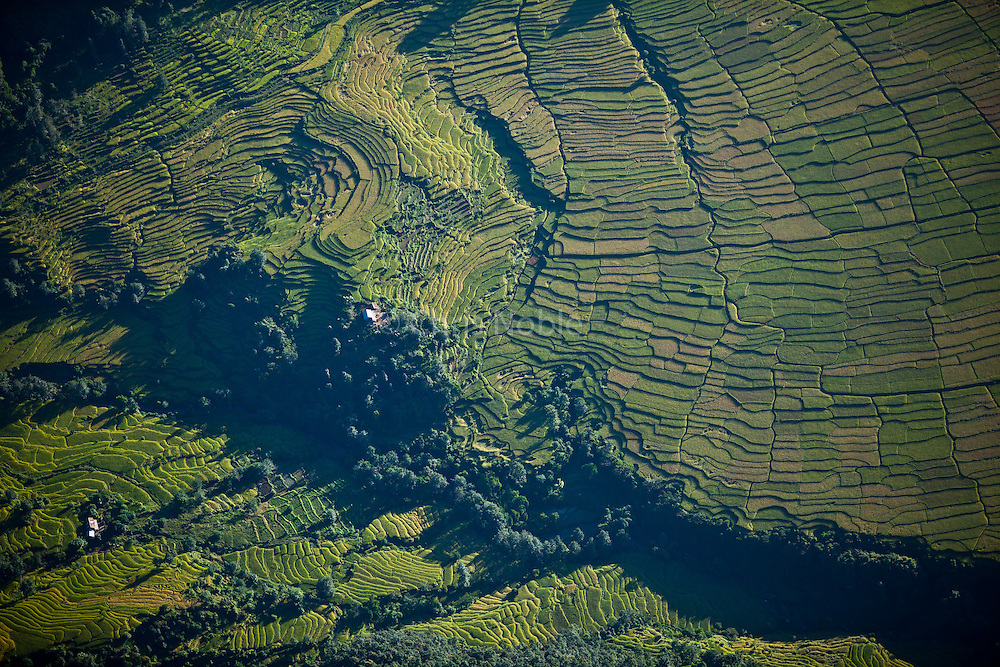 An aerial view of terraced agriculture fields in rural Nepal.