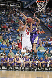 Bullitt East's Corey Washburn, left, goes strong to the basket with pressure from Bardstown's Nathan Hall. Washburn lead all scores in the first half with 19 points. Bullitt East hosted Bardstown in 7th game of  the 2011 PNC/ KHSAA Boys Sweet 16, Thursday, March 17, 2011. Photo by Jonathan Palmer