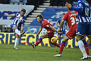 Wigan Athletic Forward, Will Grigg and currently Wigans leading Goal scorer unleashes a shot during the Sky Bet League 1 match between Wigan Athletic and Oldham Athletic at the DW Stadium, Wigan, England on 13 February 2016. Photo by Mark Pollitt.